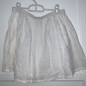 Old Navy Skirts - NEW white mini skirt with detailed pattern bottom